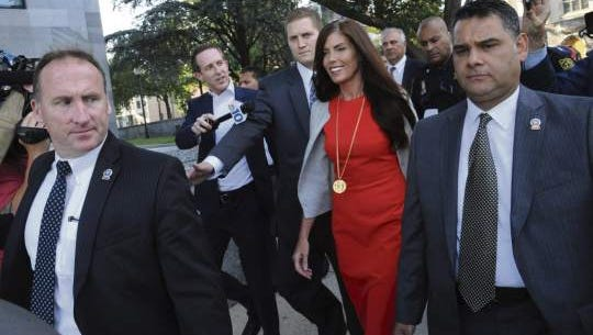 Embattled Pennsylvania Attorney General Kathleen Kane walks out of the Montgomery County Courthouse in Norristown, Pa., surrounded by her security detail, on Monday, Aug. 24, 2015, after a preliminary hearing on charges against her including perjury, false swearing and obstruction of justice.