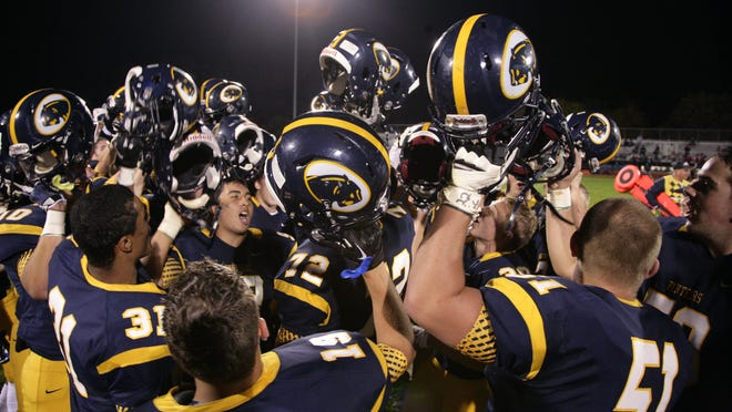 Jacob Wozniewski (72) is among the DeWitt players shown celebrating after defeating Haslett earlier this season.