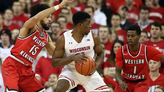 Wisconsin guard Khalil Iverson  works the ball against Western Kentucky's Darius Thompson (15) and Lamonte Bearden on Wednesday night at the Kohl Center.