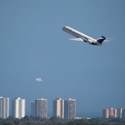 A Delta plane takes off from Daytona International Airport during the Daytona 500 on Feb. 22, 2015.