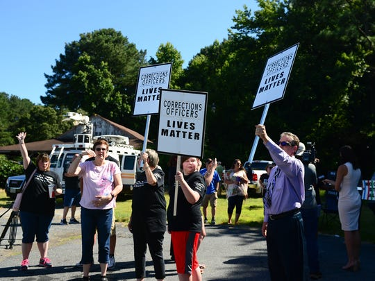 Members of the community joined together at the corner of Rt. 13 and Revells Neck Rd. In Princess Anne on Monday, July 9, 2018 to rally in support of the ECI staff.
