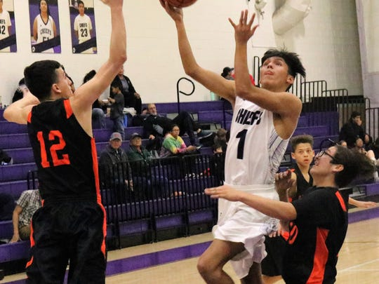 Mescalero's Matias Lapaz attempts a short-range shot while being defended by Lordsburg's Greg Cuevas (12).