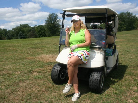 Candy Atkins of Pinckney made her second hole-in-one