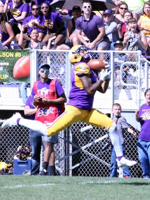 Western's Xavier Ayers catches this pass in stride for a 55-yard touchdown during homecoming action Saturday.