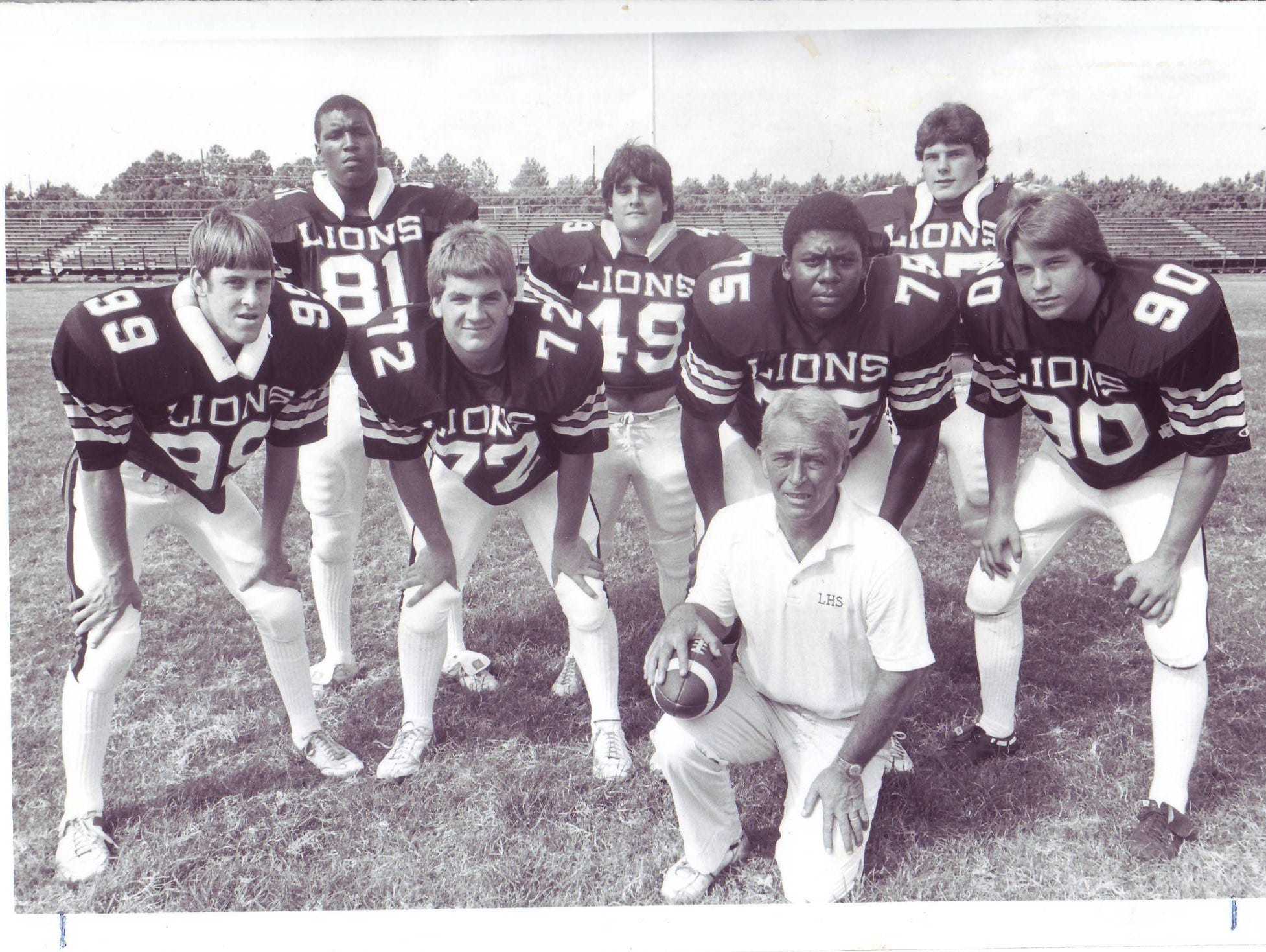 Former Lafayette High assistant coach Frank Barousse with his Mighty Lion defensive front in the early 1980s, led by standout linebackers Cedric Figaro, back left, and Randy Guidry, back right.