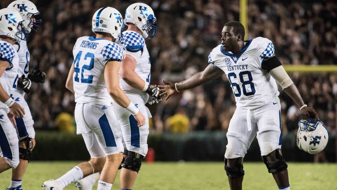 Kentucky guard Nick Haynes (68) celebrates with long snapper Tristan Yeomans (42) and teammates during the second half of an NCAA college football game Saturday, Sept. 16, 2017, in Columbia, S.C. Kentucky defeated South Carolina 23-13.