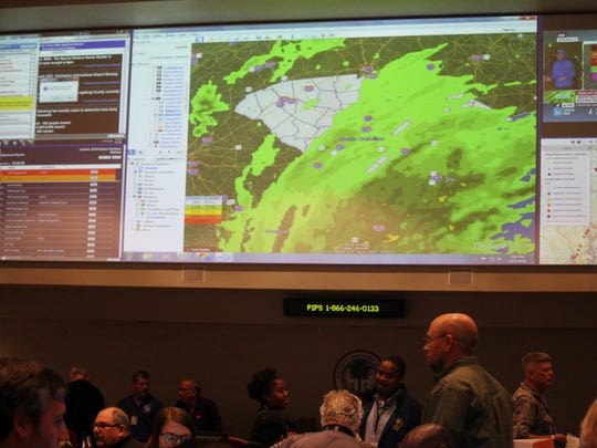 A giant screen in the state's Emergency Operations
