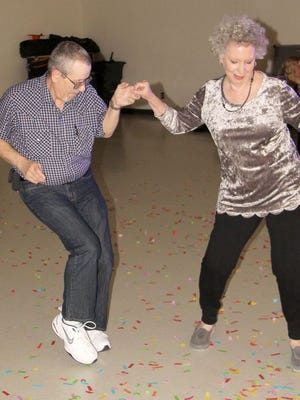 Randall Thompson and SueAnne Bertram show off some fancy footwork at the RSVP New Year's Eve dance.