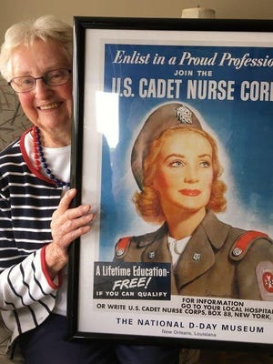 In 2018, Betty Beecher, then 94, of Weymouth holds a poster used to recruit U.S. Cadet Nurses during WWII. Now 96, Beecher, who served in the Cadet Nurse Corps, continues to advocate for their recognition.