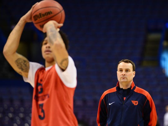 Archie Miller looks on as Dayton guard Kyle Davis shoots