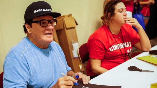 Baseball fans had the opportunity to meet players of the Big Red Machine during the Cincy Sports Fest at the Northern Kentucky Convention Center Sunday. Pete Rose signs a variety of items for fans during the convention.