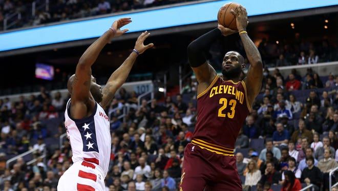 Cleveland Cavaliers forward LeBron James (23) shoots the ball over Washington Wizards guard Marcus Thornton (15) in the first quarter at Verizon Center.