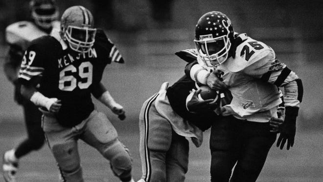 CAPE's Carlos Snow tries to shake the grasp of a Kenston defender in the Crusaders' 1986 title game.