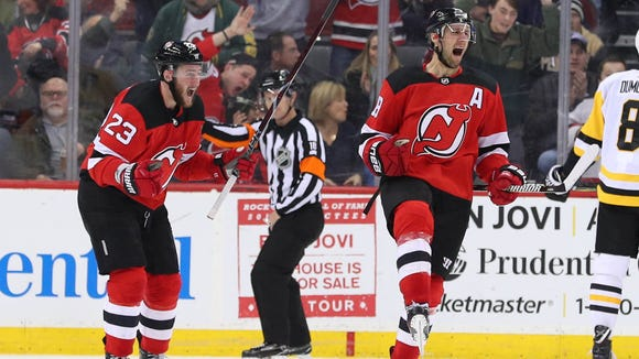 New Jersey Devils center Travis Zajac (19) and New Jersey Devils right wing Stefan Noesen (23) celebrates Zajac's goal during the third period of their game against the Pittsburgh Penguins at Prudential Center on Saturday, Feb. 3, 2018.