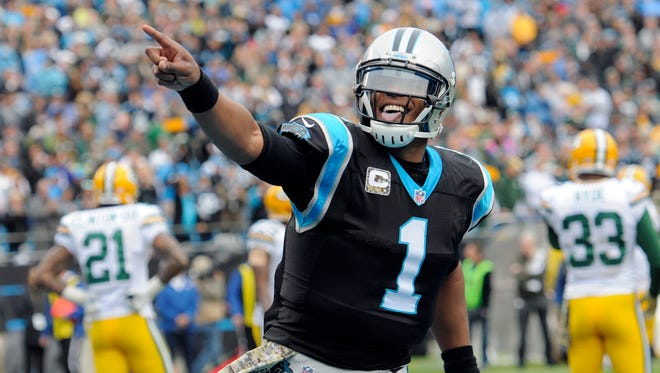 FILE - In this Nov. 8, 2015, file photo, Carolina Panthers quarterback Cam Newton (1) celebrates his touchdown pass against the Green Bay Packers during an NFL football game in Charlotte, N.C. The Panthers are one of three unbeaten teams heading into the second half of the season. (AP Photo/Mike McCarn, File)
