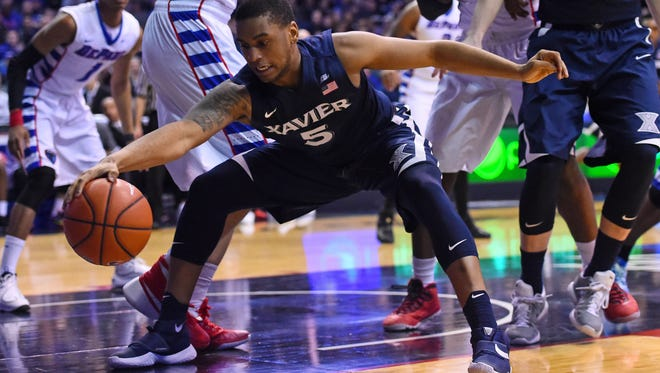 Xavier Musketeers guard Trevon Bluiett (5) saves the ball against the DePaul Blue Demons during the first half at Allstate Arena.