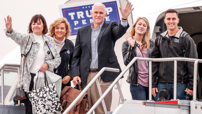 Indiana governor Mike Pence -- now the vice president-elect -- prepares to depart with his family out of Indianapolis to fly to New York on Election Day.