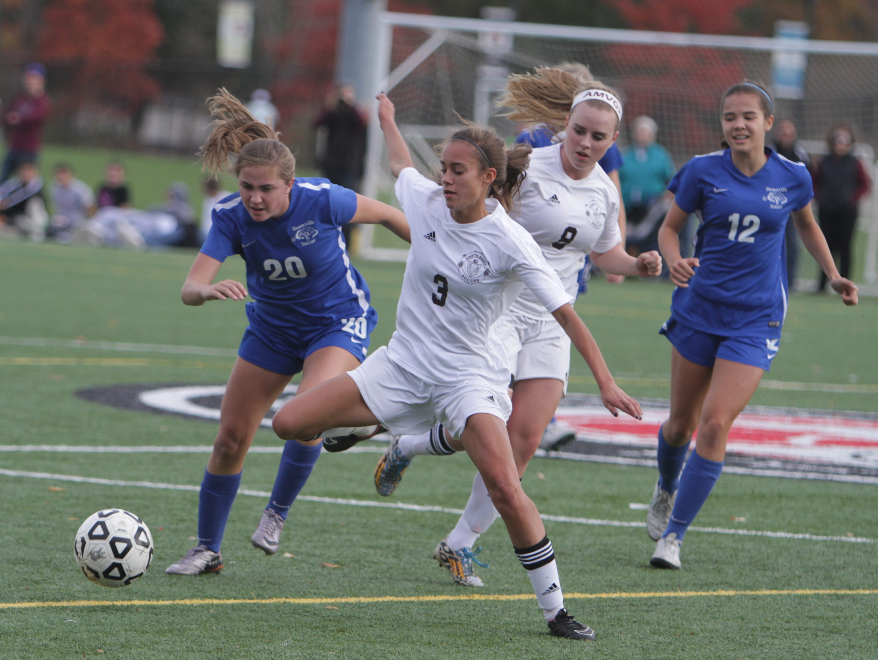 Bronxville's Natalie Kister (12) and Albertus Magnus' Danielle LaRochelle battle for a loose ball during a Section 1, Class B semifinal game at the Orangetown Soccer Field Complex on Thursday, October 29th, 2015. Albertus Magnus won 1-0.
