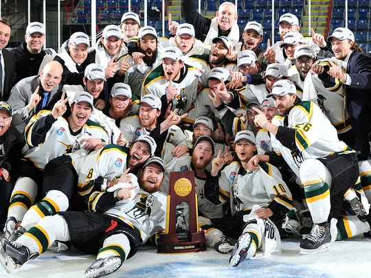 St. Norbert College players and coaches celebrate their