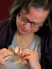 Marianne Thouret of Matawan holds a photograph inside her locket of her son, Justin Thouret, who passed away on December 31, 2015 due to a heroin overdose, in her home in Matawan, NJ Wednesday April 27, 2015.