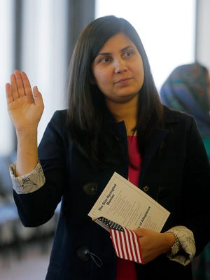 Sobia Gul of Branchville, who immigrated from Pakistan, becomes a citizen of the United States during a naturalization ceremony at Peter Rodino Federal Building in Newark, NJ Thursday May 12, 2016.