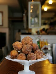 A specialty at Cardinal Provisions are housemade xuixos, a Catalonian fried pastry with pastry cream inside.
