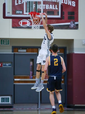 Zack Kroker dunks one home during the Rattlers' 98-91 victory over Westbury Christian on Monday.