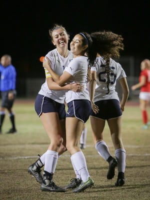 Jaylene Manion celebates with a teammate after scoring for the La Quinta Blackhawks. La Quinta is the top seed in Division 4.