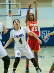 Hemet topped Shadow Hills 50-26 on Thursday in the first round of the girls' basketball playoffs. Here, Shadow Hills' Annabelle Amador boxes out on a free throw attempt.