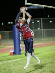 Christian Sanchez with a touchdown. La Quinta defeats Palm Springs, 38-14.