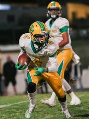 Angelo Fitzgerald runs to the right of the field. The Coachella Valley varsity football team won Thursday's away conference game against Yucca Valley by a score of 29-28.