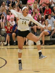 Golden Hinchen celebrates as her Xavier Prep Saints topped Palm Desert 3-1 in a crucial volleyball game Monday.