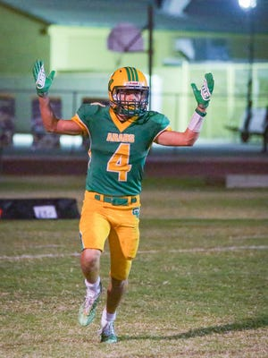 Angelo Fitzgerald celebrates at the end after a touchdown. The Coachella Valley varsity football team won Friday's home playoff game against Ramona by a score of 45-7. This is the first home football playoff game for the Arabs since 1988.