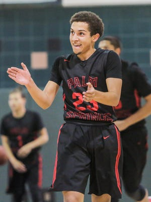 Kaelan Richter celebrates after sinking the ball behind the 3 point line.