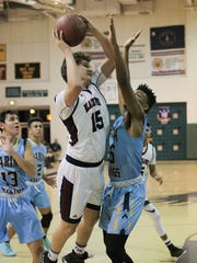 La Quinta senior Tommy Mooney puts in a tough basket against Marina in a playoff game on Wednesday night.