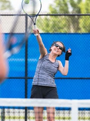 Karen Chavez returns a shot during the last class of the Try Tennis program offered through the Asheville Tennis Association at the Aston Park tennis courts, Monday, May 21, 2018.