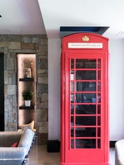 An antique phone booth on the ground floor at the home of Marty and Peter Vexter at the Cliffs at Walnut Cove in Arden.