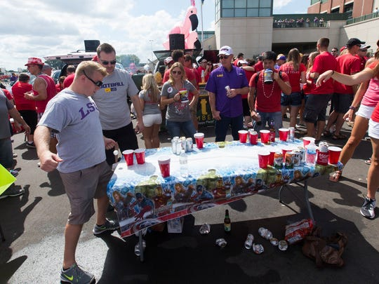 LSU fans and Wisconsin fans play a game of beer pong.