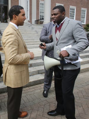 From left, Mount Vernon Mayor Richard Thomas talks to Pastor Edward Mulraine of Unity Baptist Tabernacle Church after a press conference outside of City Hall in Mount Vernon April 3, 2017. Clergy members in Mount Vernon push for an end to government gridlock that has plagued their city.