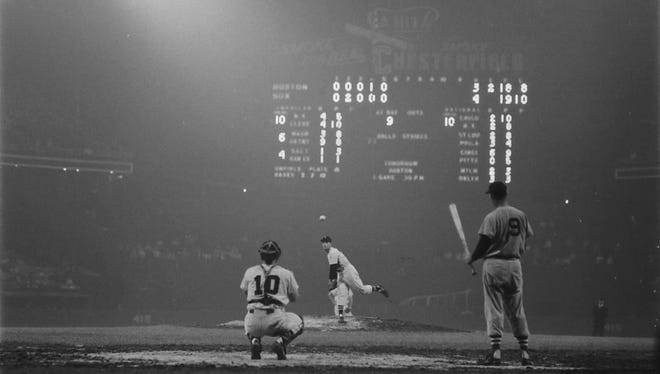 Chicago White Sox pitcher Billy Pierce warms up before the top of the sixth inning Aug. 23, 1957, in old Comisky Park, with Ted Williams waiting to take his cuts. Behind the plate is Sherm Lollar. Williams struck out in this at-bat and went 0-for-4. The White Sox won 4-1, with Pierce going the distance in his 17th win. Lollar went 1-for-3 with one RBI. It was his 33rd birthday.