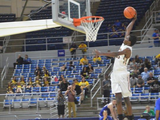 Grace Christian junior Elijah Hampton skies for a dunk against Crescent City Monday.