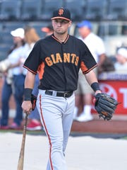 San Francisco Giants second baseman Joe Panik walks to the dugout after batting practice before a game against the New York Mets at Citi Field on Tuesday.