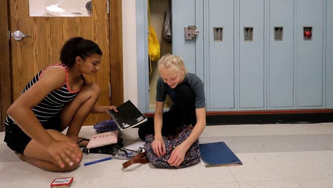 Seventh grade students Olivia Weyenberg, left, and Adyssa Roh prepare Thursday for Friday's last day of school at Roosevelt Middle School in Appleton.