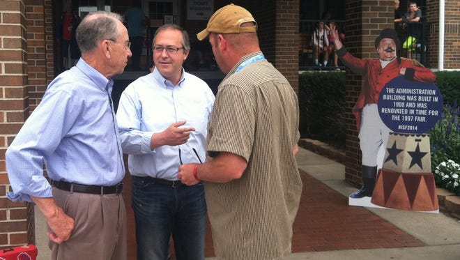 U.S. Sen. Chuck Grassley, R-Iowa, with David Young, center, during a visit to the Iowa State Fair in August.