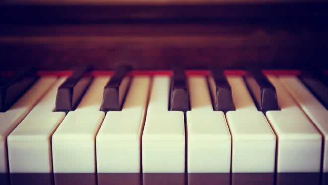 Piano keyboard, closeup with shallow depth of field. Vintage filter effects.