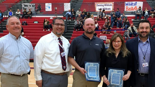 Deming Public Schools honored 1st New Mexico Bank and Deming Coca-Cola for their support of Deming Public Schools activities and athletics. Representatives Charles Schultz and Rosa Perez were on hand at half time of a Wildcat basketball game to accept certificates. Pictured from left are Herb Borden, Bernie Chavez, Schultz, Perez and Arsenio Romero.