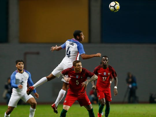 Tyler Adams jumps for a high ball during an international friendly match against Portugal at the Dr. Magalhaes Pessoa stadium in Leiria, Portugal on Tuesday.