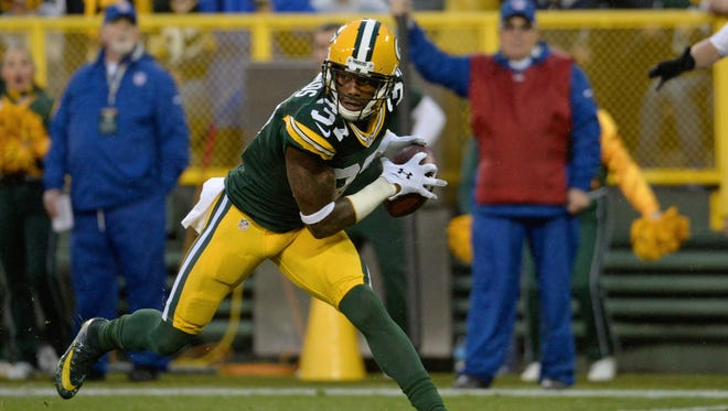 Green Bay Packers cornerback Sam Shields (37) intercepts a pass in the end zone in the first quarter.