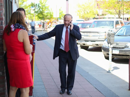 Congressman Steve King speaks on his cellphone outside at Old Main Brewing Company in Ames on Friday, May 6, 2016.