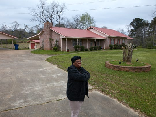 Renee Hill, outside her mother's home where Odell Hallman